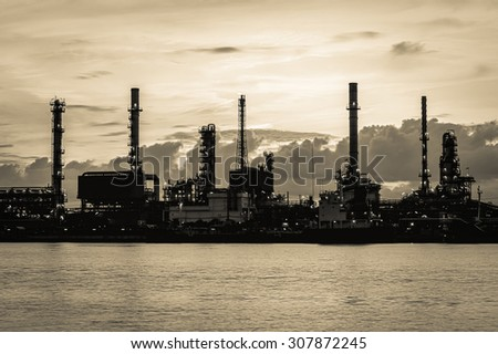 Oil refinery along the river (Bangkok, Thailand).Vintage tone - stock photo