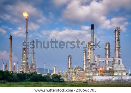 Oil refinery along twilight sky - stock photo