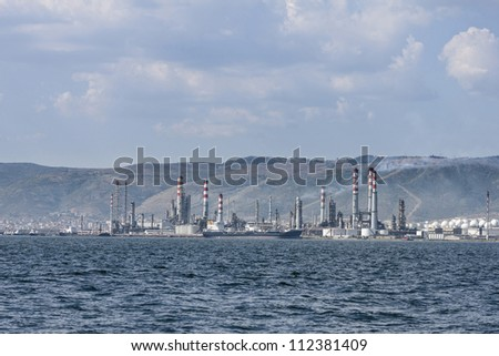 oil refinery and oil tankers - stock photo