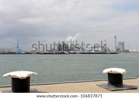 oil refinery and oil tankers in the port of rotterdam - stock photo