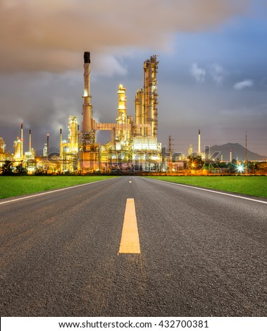 Oil refinery and road at twilight. - stock photo
