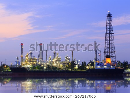 Oil refinery and Ship fuel delivery at twilight in bangkok, Chao Phraya river, Thailand - stock photo