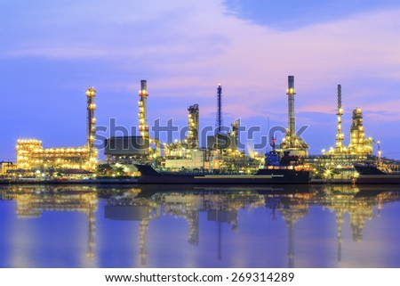 Oil refinery and Ship fuel delivery at twilight in bangkok, Chao Phraya river, Thailand