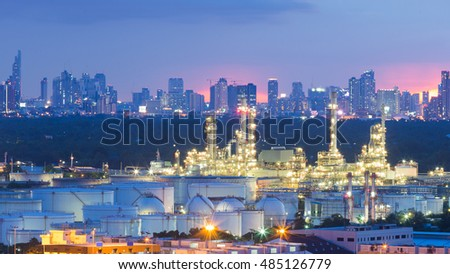 Oil refinery and Tank with city downtown background night view