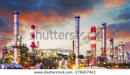 Oil refinery at dramatic twilight - stock photo