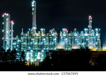 Oil refinery at night in Rayong, Thailand - stock photo