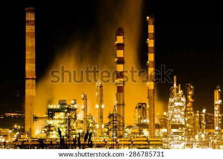 oil refinery at night Industry and factories backgrounds - stock photo