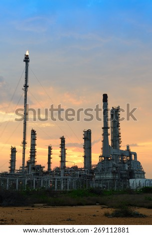 Oil refinery at sunrise - stock photo