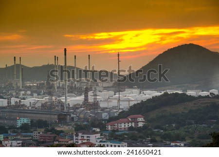 Oil refinery at sunset - stock photo