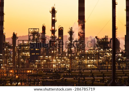 oil refinery at sunset Industry and factories backgrounds - stock photo