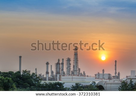 Oil refinery at sunset, petrochemical plant - factory