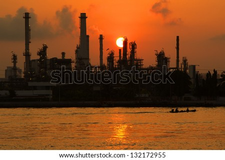 Oil refinery at twilight beside Chao Phraya river in Bangkok,Thailand - stock photo