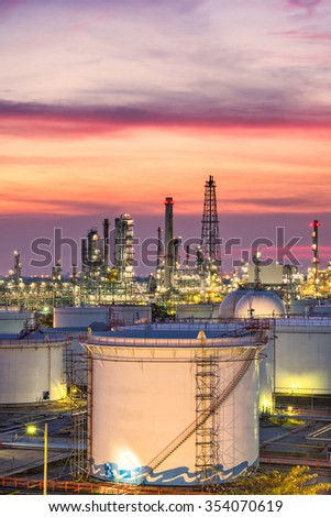 Oil refinery at twilight - factory - petrochemical plant - stock photo