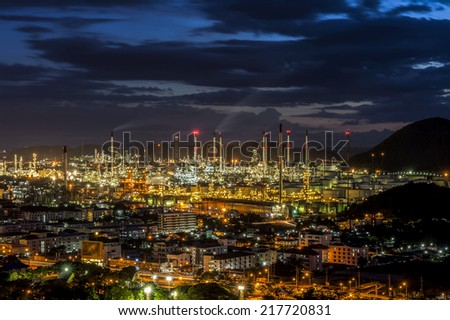 Oil refinery at twilight - petrochemical industry  - stock photo