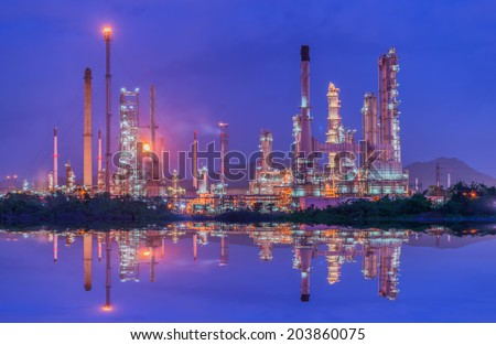 Oil refinery at twilight - petrochemical industry with water reflect - stock photo