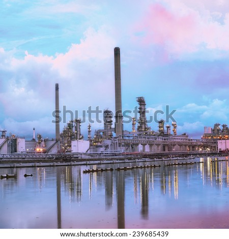Oil refinery at twilight - petrochemical industry with water reflect