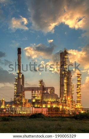Oil refinery at twilight sky - stock photo
