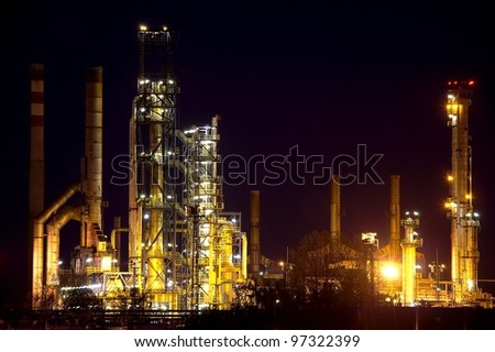 Oil refinery building at night