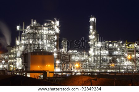 Oil refinery by night - stock photo