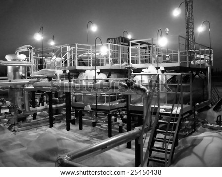 Oil refinery center. Work of oil industry. Black and white photo - stock photo