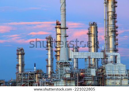 oil refinery chimney in heavy industry estate against beautiful dusky sky use for petrochemical industrial and fuel energy business  - stock photo