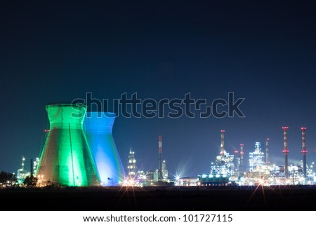 Oil refinery colored lights at night - stock photo