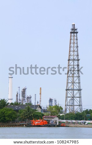 Oil Refinery distillation Tower over river