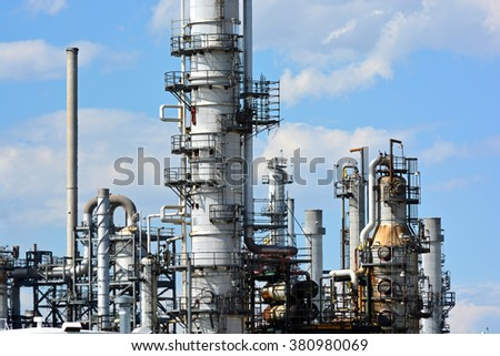 Oil Refinery Distillation Towers on a Sunny Day - stock photo