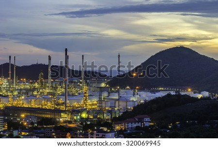 Oil Refinery factory at dark , petrochemical plant , Petroleum , Natural Gas storage tanks - stock photo