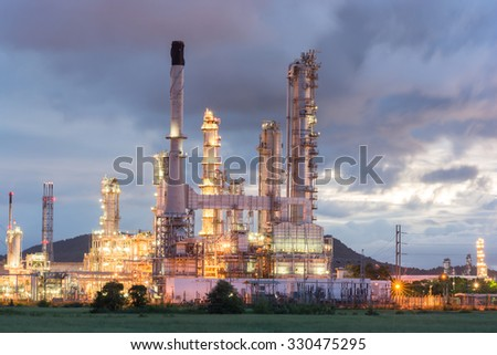 Oil Refinery factory at dark , Petroleum, petrochemical plant - stock photo