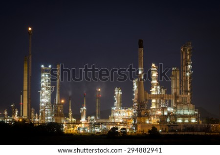 Oil refinery factory in night ,petrochemical plant , Petroleum