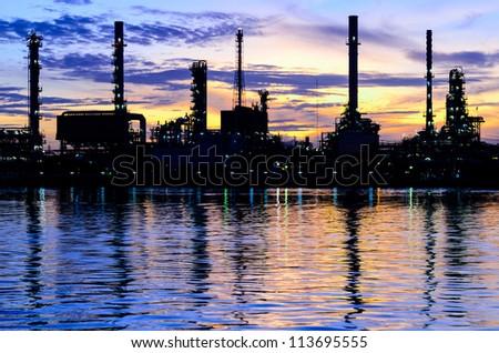 Oil refinery factory over sunrise Bangkok Thailand - stock photo