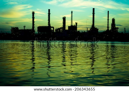 Oil refinery factory over sunrise Bangkok Thailand - stock photo