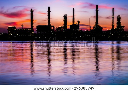 Oil refinery factory over sunrise Bangkok Thailand,Oil refinery with silhouette - stock photo