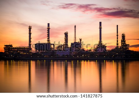 Oil Refinery Factory with Reflection on the river. - stock photo