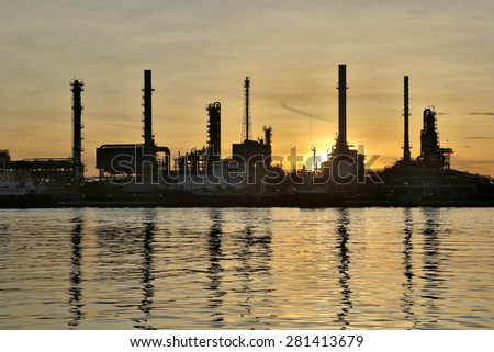 Oil refinery factory with sun rise. - stock photo