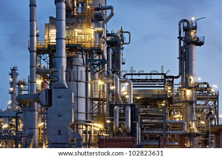 Oil refinery in Hamburg, Germany, petrochemical industry night scene - stock photo