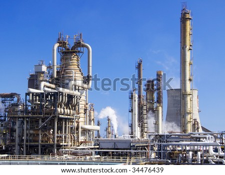 Oil refinery in Italy Milazzo Sicily with tall smokestacks - stock photo