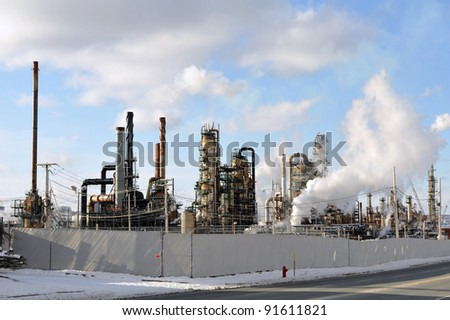 Oil refinery in Nova Scotia Canada, example of ugly polluting industrial sites. - stock photo