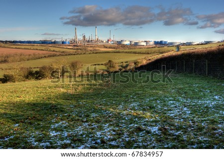 Oil refinery in Pembrokeshire with snow in the foreground