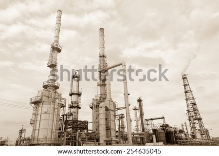 Oil refinery in sepia in New Mexico state, USA - stock photo
