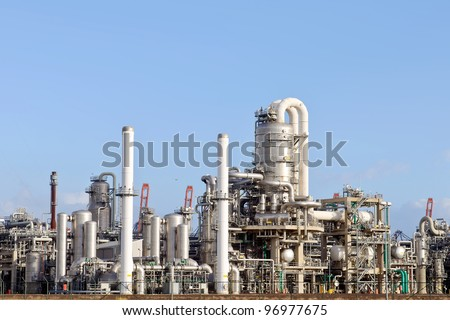 oil refinery in the harbor of rotterdam netherlands - stock photo