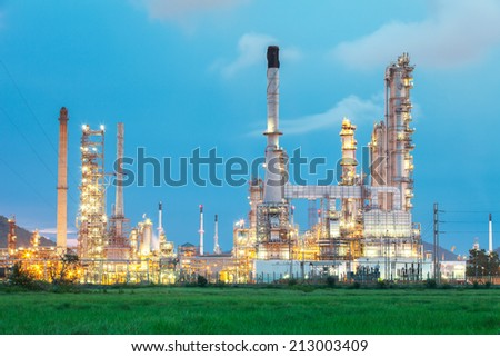 Oil refinery in the middle of field (Thailand) - stock photo