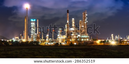 Oil refinery industrial construction in night time