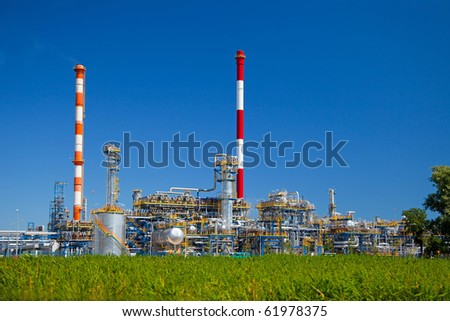 Oil-refinery, industrial-plant under blue sky. - stock photo