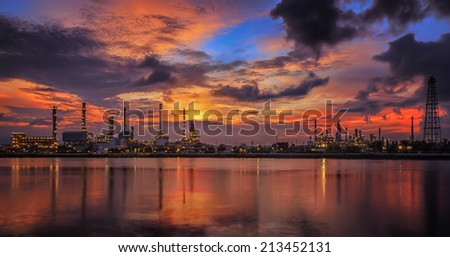 oil refinery industry plant along twilight morning - stock photo