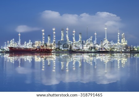 oil refinery industry plant at night time - stock photo