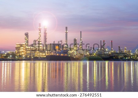 oil refinery industry plant at twilight morning , lens flare technician - stock photo
