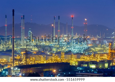 Oil refinery lights night view with mountain background, industrial landscape background