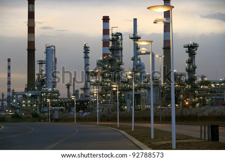 Oil refinery near a road in the early morning light (dawn)
